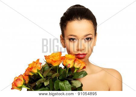 Beautiful young african woman with roses.