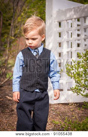 toddler boy dressed up in suit