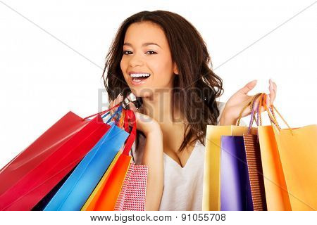 Young happy smiling woman with shopping bags.