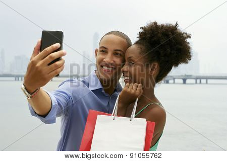 African American Couple Shopping Taking Selfie With Mobile Phone
