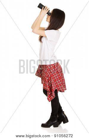 Young teenage woman with binoculars.