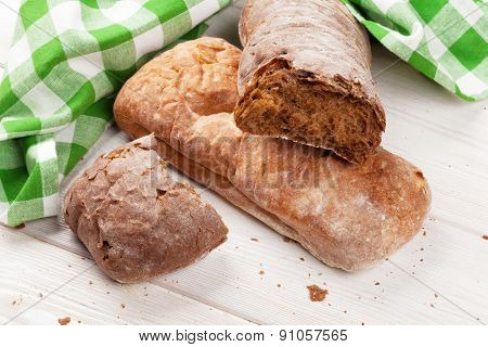 White and brown ciabatta on wooden table