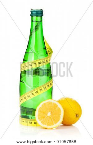 Water bottle, measuring tape and fresh lemons. Isolated on white background