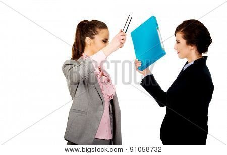 Angry frustrated businesswomen fighting with their binders.