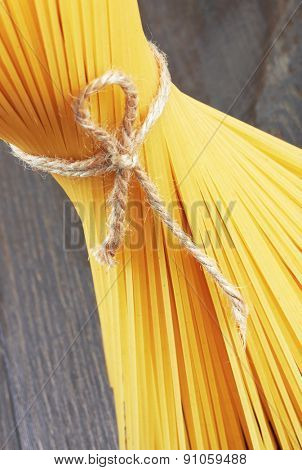Spaghetti italian pasta on wood background, close-up