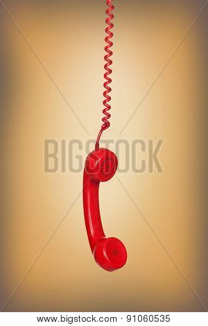 Old phone hanging wire on brown background