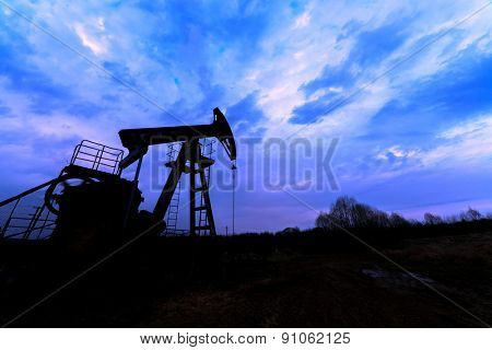 oil pump silhouette against blue sky