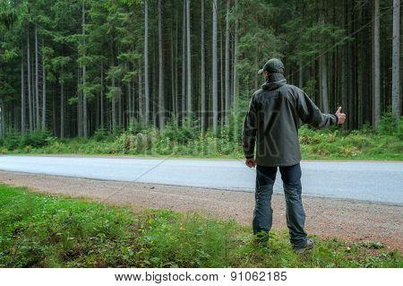 men stopping car on roadside
