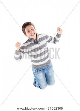 Happy boy jumping isolated on a white background