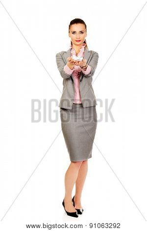 Beautiful business woman holding an airplane model.