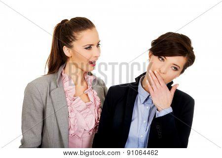 Businesswoman shouting on her yawning partner.