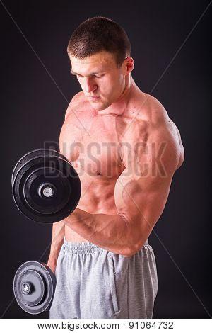 Man makes exercises dumbbells. Sport, power, dumbbells, tension, exercise