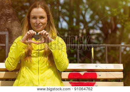 Girl Folded Her Fingers In The Form Of Heart