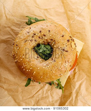 Delicious bagel sandwich on the table