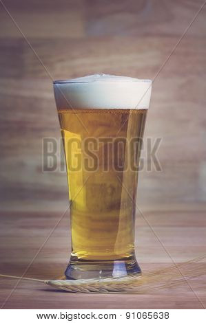 Glass Beer And Bale On Wood Background, Soft Focus