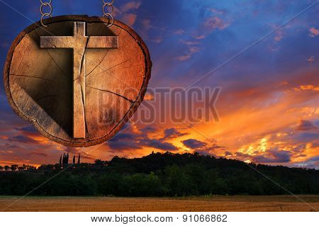 Wooden Cross On Tree Trunk At The Sunset