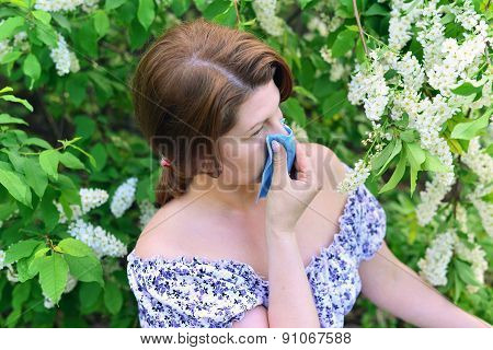 Woman With Allergic Rhinitis About Bird Cherry Blossoms