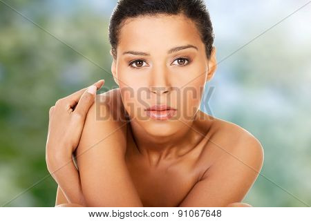 Beautiful tanned spa woman with perfect skin.