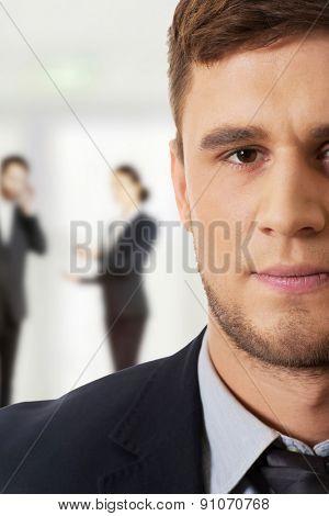 Successful confident businessman in business suit.