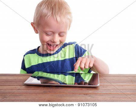 Boy Sitting With Digital Tablet
