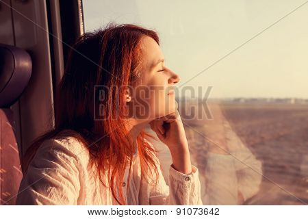 Traveling Comfort -Young woman sleeping feeling relaxed traveling  in the train.