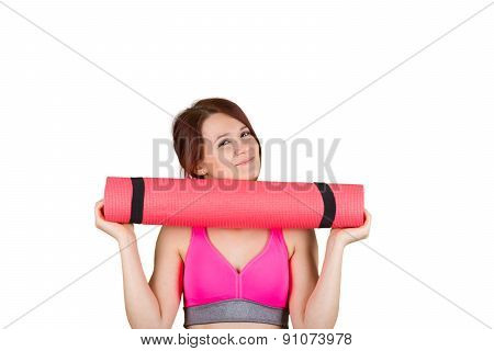 Sporty fit healthy smiling beautiful woman, red head girl holding  an yoga mat .Exercise, fitness.Wo