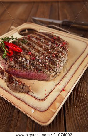 cut off  Beef steak on a wooden board and table
