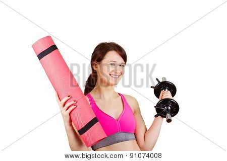 Sporty fit healthy smiling beautiful woman, red head girl holding  an yoga mat  and a dumbbell.Exerc