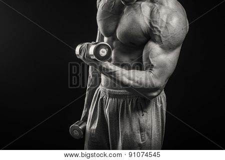Man makes exercises dumbbells