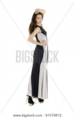 Portrait in full growth of a young woman in long evening dress, isolated on white