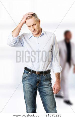 Stressed businessman with a headache.