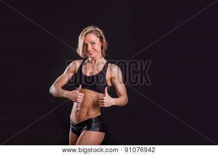 Sexy, athletic girl on a black background