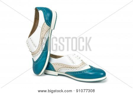 Beautiful blue woman shoes isolated on white background