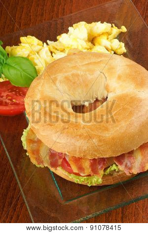 Bacon And Cheese Bagel With Scrambled Eggs