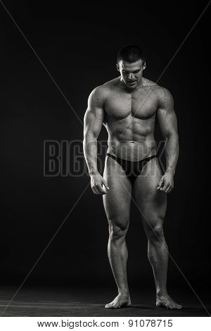 Strong, muscular guy on a black background.