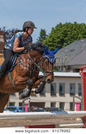 Closeup Of Horsewoman Jumping. Vertically.
