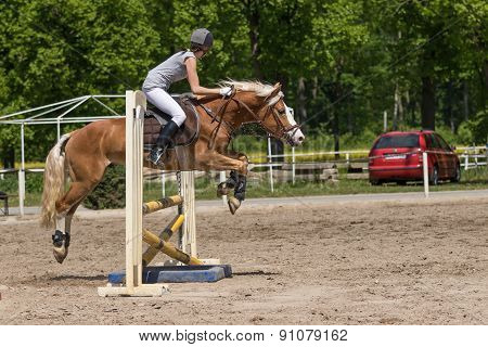 Side View Of Horsewoman Jumping