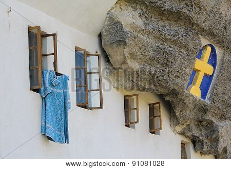 Cassock Clerics Posted Outside. Assumption Monastery Of The Caves, Crimea