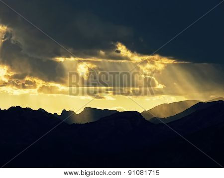 Sunbeams through the clouds on mountain
