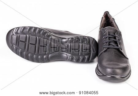 Black shoe sole and front view.