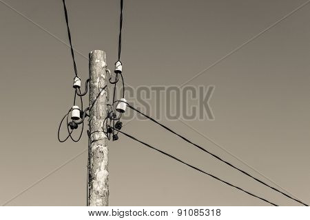 Wooden Column With Electric Wires Of Beige Color