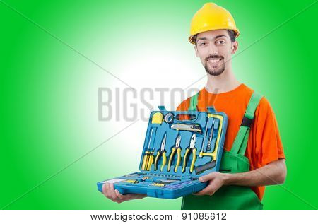 Repairman in coveralls in industrial concept