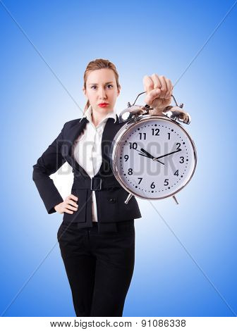 Woman businesswoman with giant clock