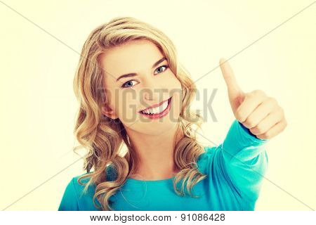 Happy smiling woman with ok hand sign