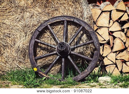 Wooden Wheel, Firewood And Hay