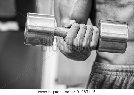 Man in the gym. Working out with weights.