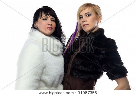 Portrait of women in fake fur coats