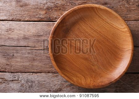 Wooden Plate On A Rustic Table Closeup. Horizontal Top View