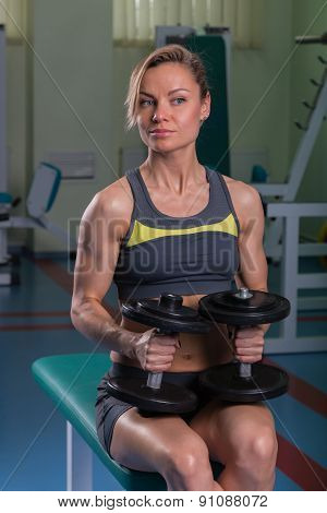 Beautiful, sexy, muscular blonde in the gym