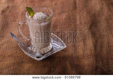 Woman eating dairy dessert spoon.